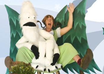 Image of Emma Boor in character posing with a puppet